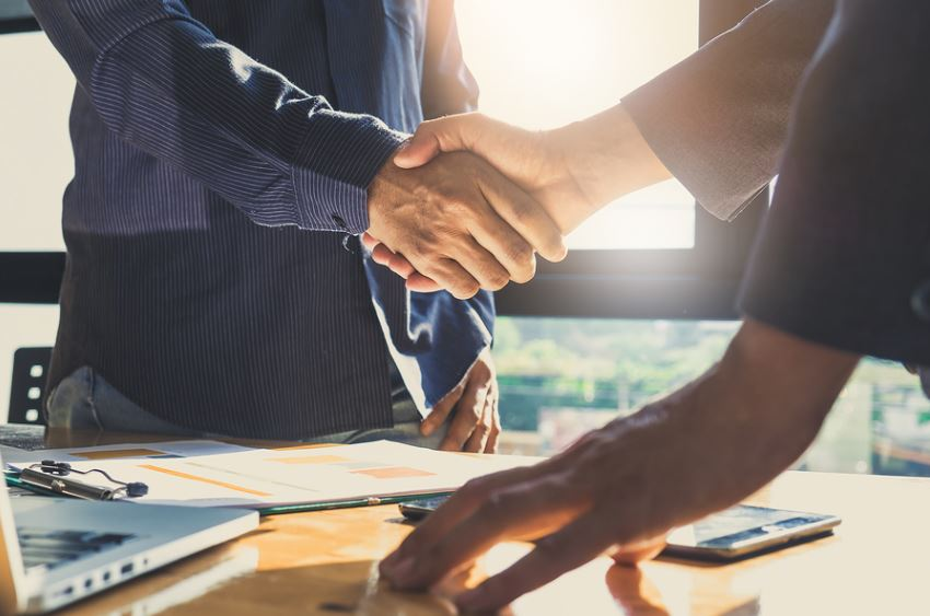 men-shaking-hands-over-business-agreement