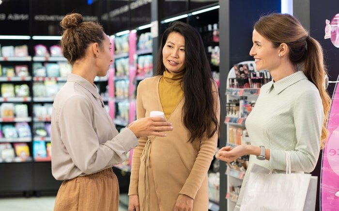 Store owner talking to customers