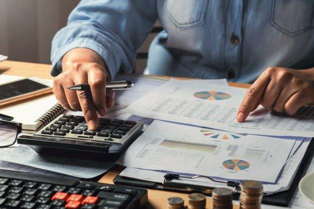 Man using a calculator