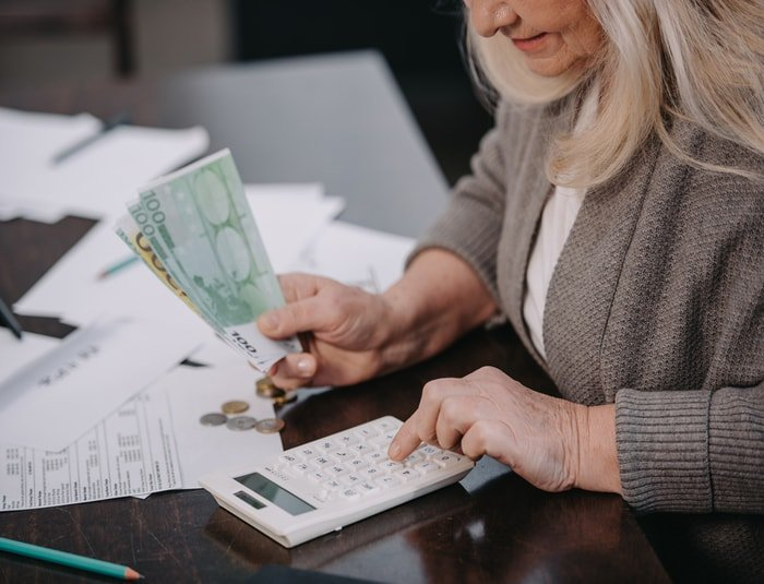 Woman counting money for farming business