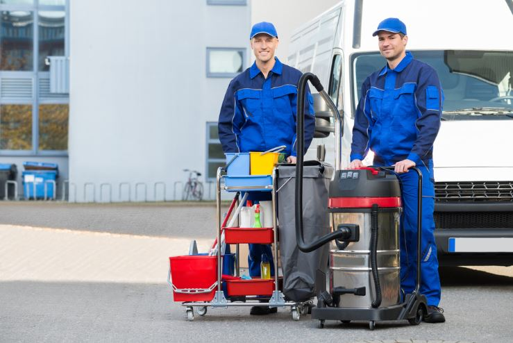 Two man standing with cleaning equipment