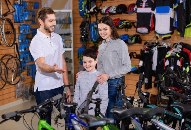 Customers buying bike in a bike shop