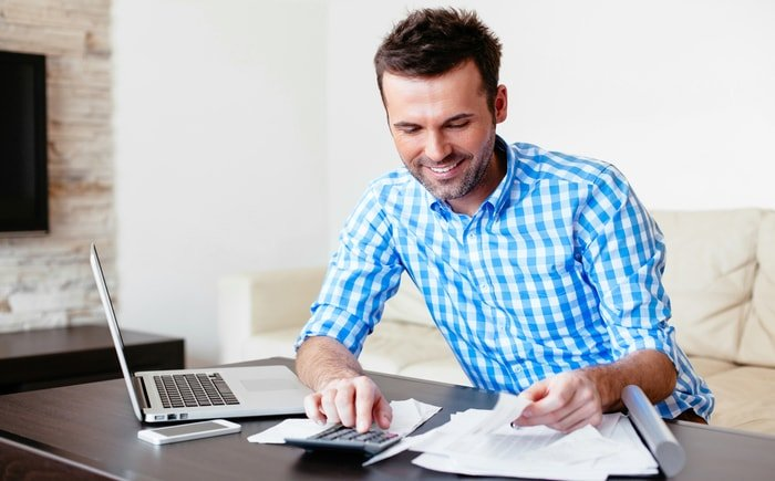 Business owner at his desk checking the expenses