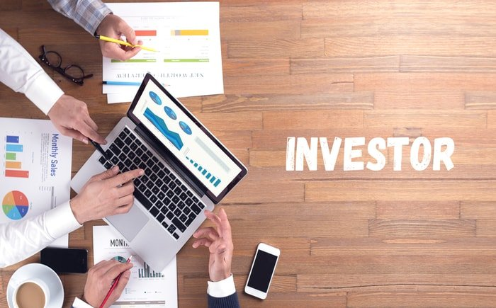 Group of people planning on investing for business