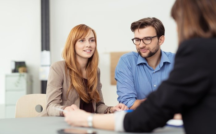 Entrepreneurs cosnsulting a business broker
