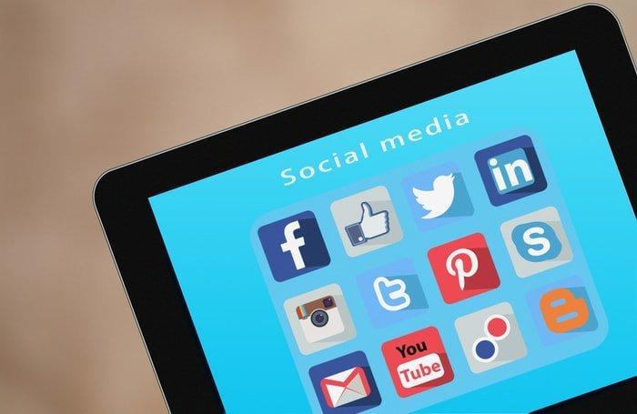 Different social media platforms shown on a tablet