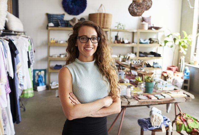 A woman with eyeglasses with her clothing business