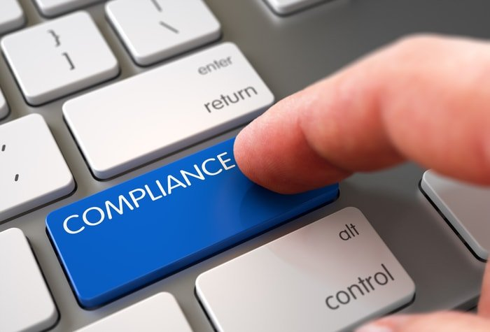 "Keyboard with the word ""compliance"""