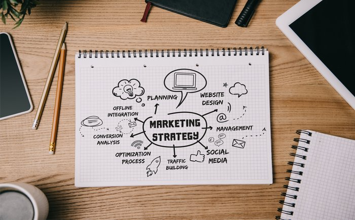 """A sketch pad with the words """"marketing strategy"""""""