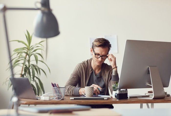 A man at his desk working remotely
