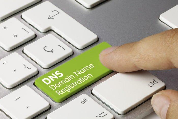 Domain name registration written on a green keyboard