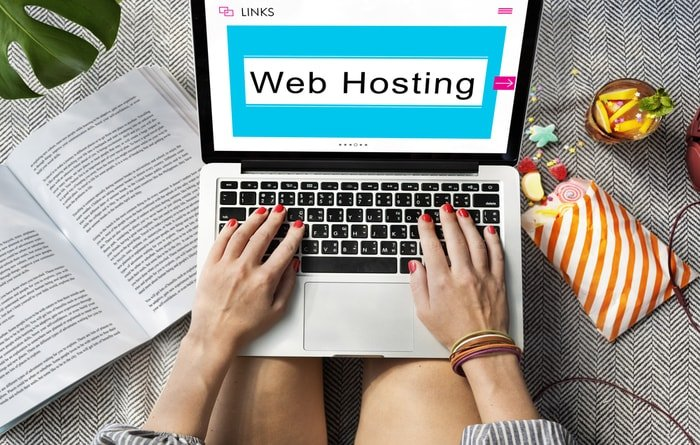 A women searching for a good web hosting provider on her laptop