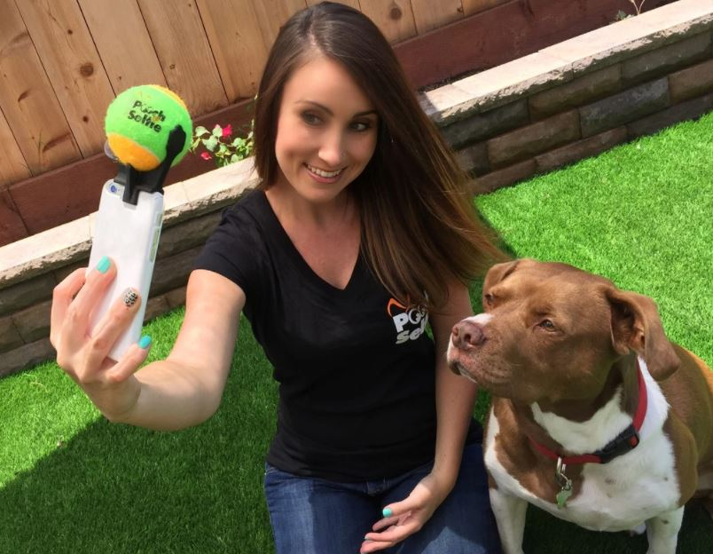 Woman taking picture with pooch selfie product