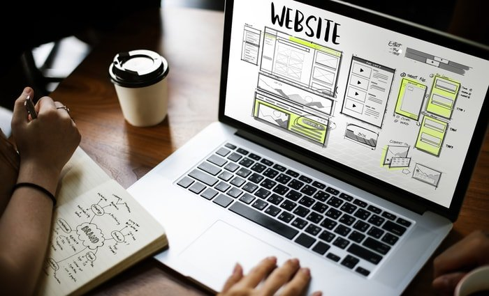 An entrepreneur creating a website for his business