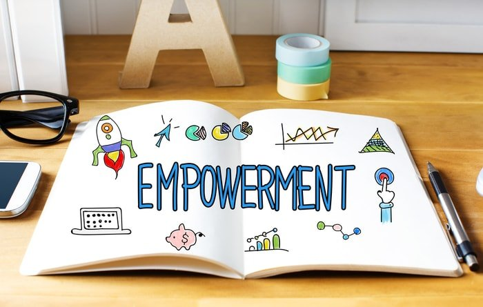 """A white book with doodles and the word """"empowerment"""""""