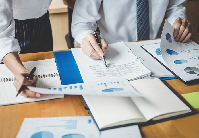An employee managing the financial records of company