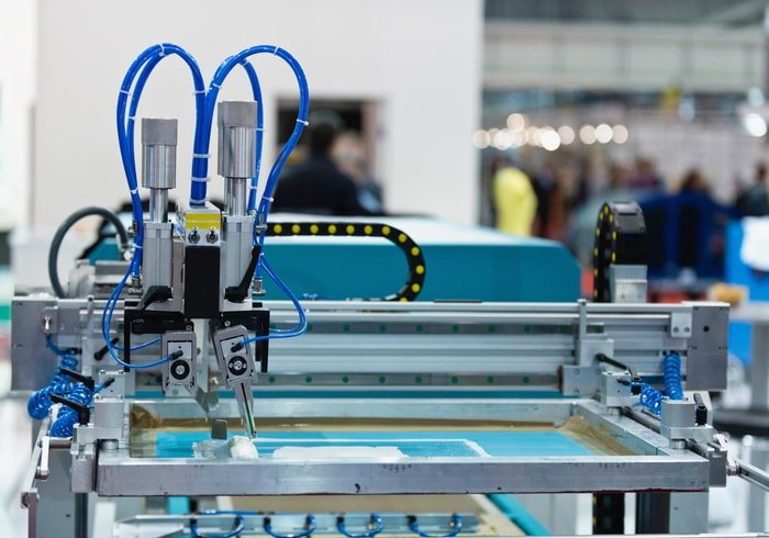 A printing machine inside a factory